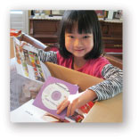 Homeschool girl opening package